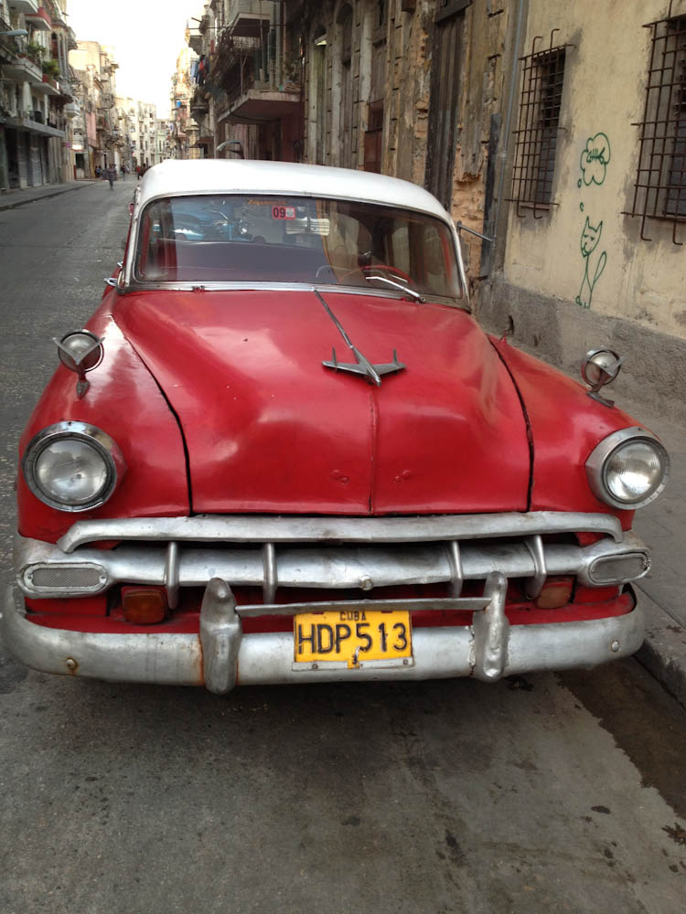 Legal or not, many cars do taxi service around Havana. Just flag them down and ask!