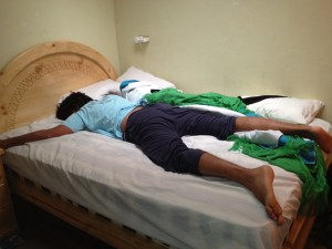 Ashray looks like a giant in the average Ecuadorian bed!