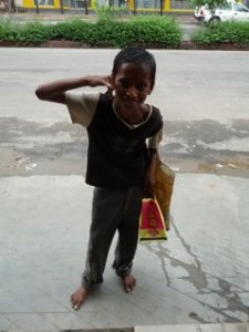 The young beggar with his happy meal :)
