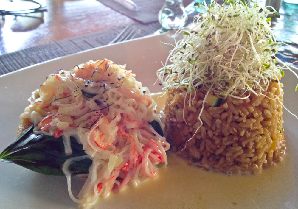 Fish net: tender white fish covered with crab, with sides of rice and alfalfa sprouts.