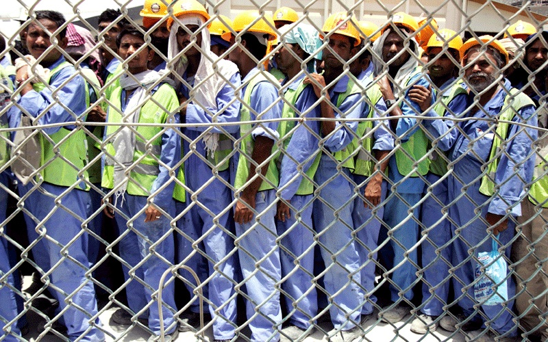 "Laborers queuing for the ride back ""home"" (photo from moveoneinc.com)"