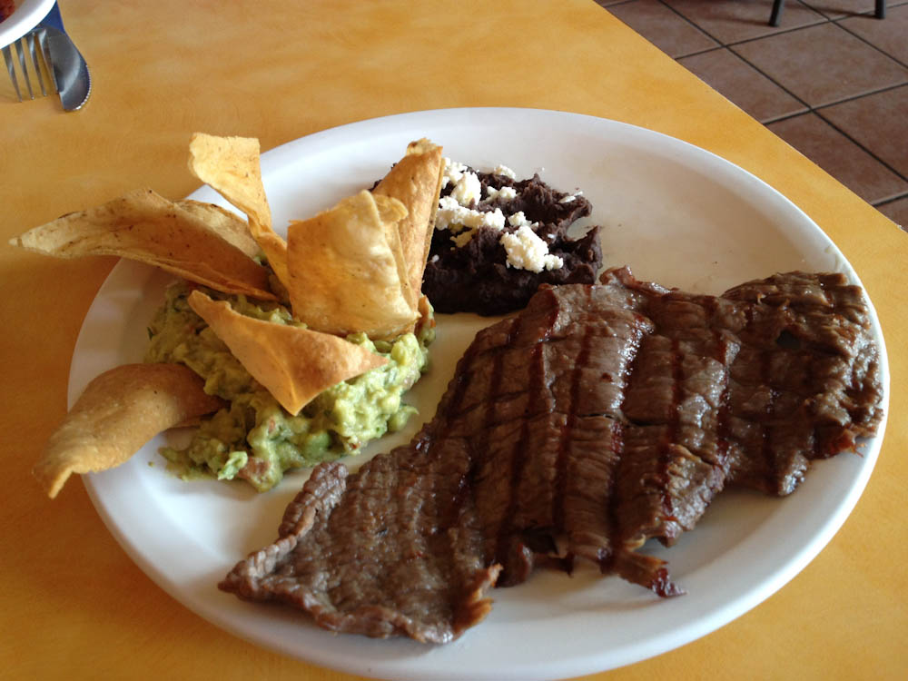 Lunch time in Oaxaca: steak, mashed black beans with cheese, guacamole and corn tortillas