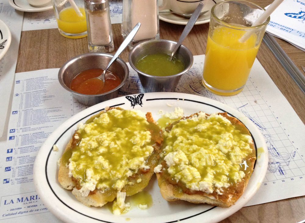 Molletes: bread with refried beans, cheese and green sauce. EVERYTHING is saucy in Mexico!