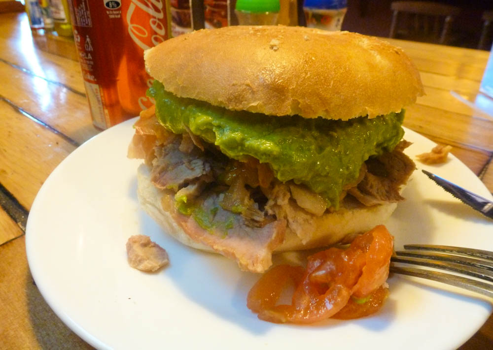 Chilean sandwiches are MASSIVE! This one is &quot;lomito&quot;: saucy pork loin with mashed avocado.