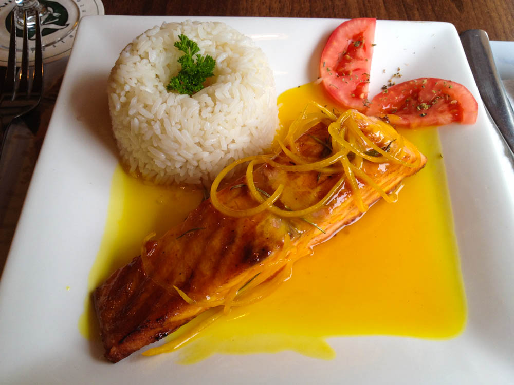 Grilled salmon with orange sauce.