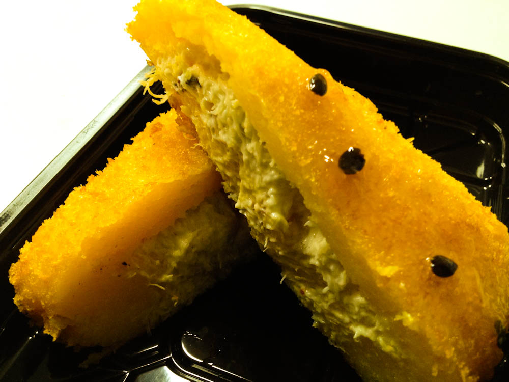 Causa de cangrejo: potato pure stuffed with shredded crab, deep fried and covered in passion fruit sauce.