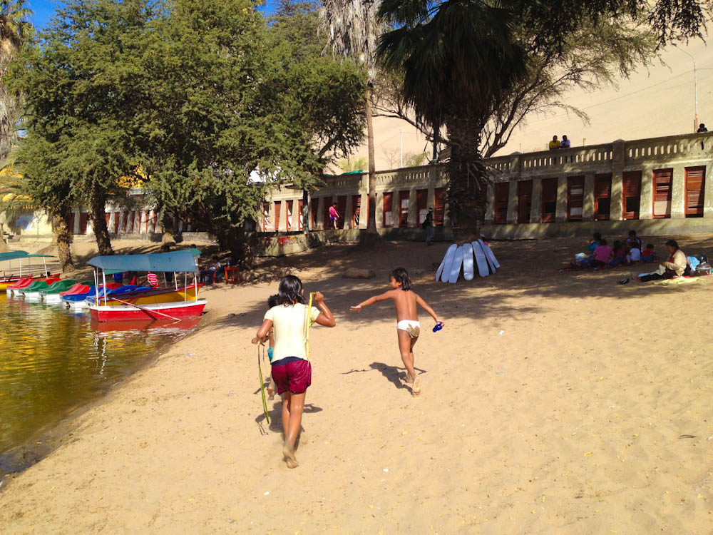 The sand in the lagoon shore is a great playground on a sunny day!