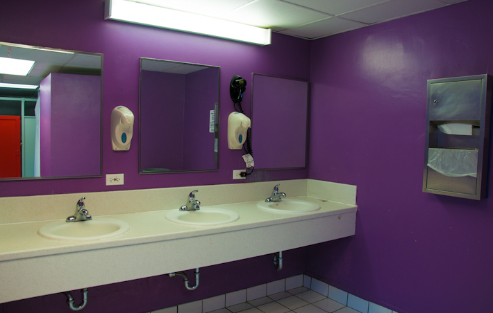 A colorful shared bathroom