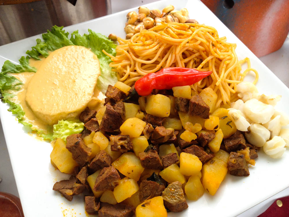 Peruvian Chanfainita: a stew of beed and potatoes, here served with a side of noodles