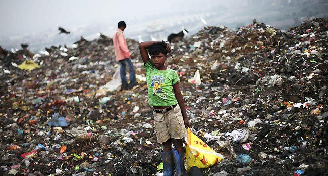 Indian kid on a mountain of trash: a cliche, yes, but not everyone is like this...