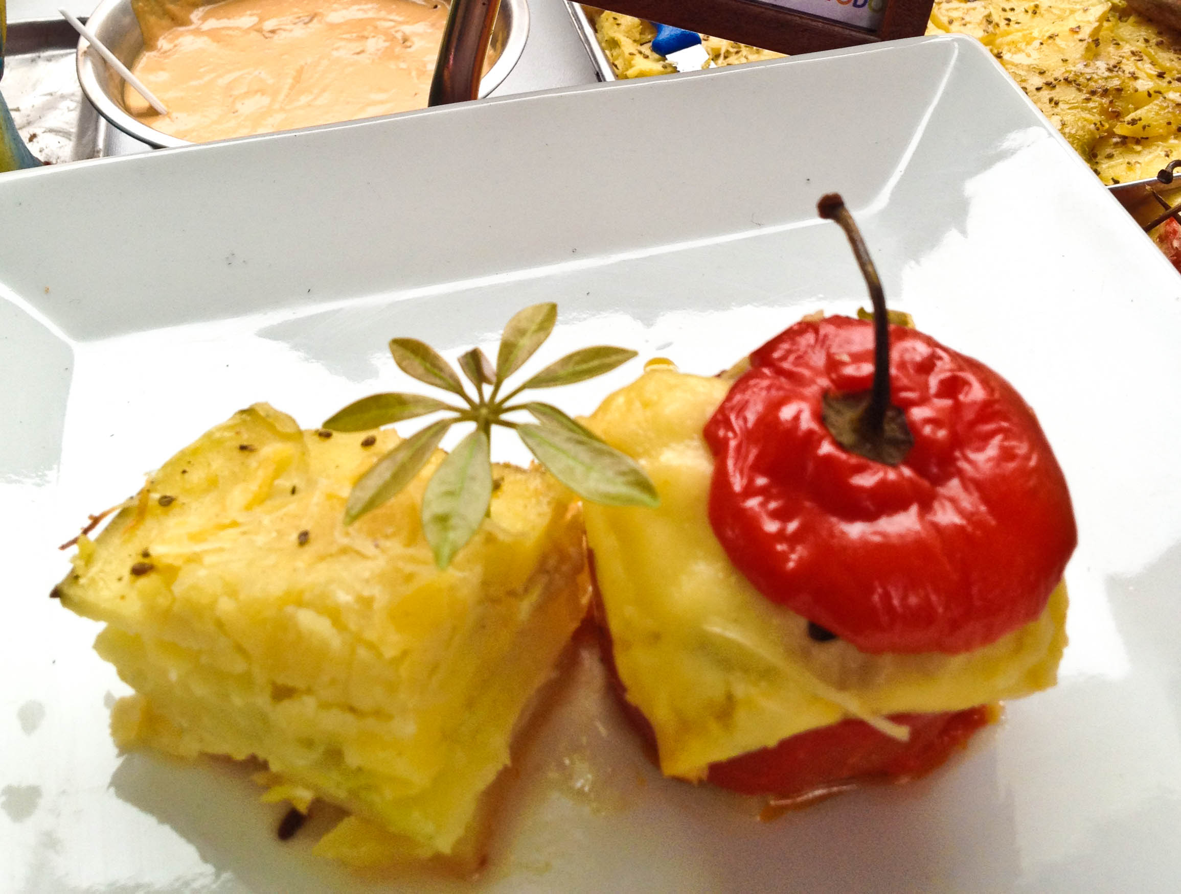 Rocoto Relleno: mildy spicy pepper stuffed with meat and cheese and a side of baked layered potatoes.