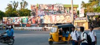 Movie posters decorate the streets of Pondi