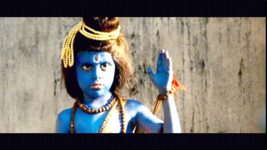 Kid dressed as Shiva - scene from Slumdog Millionaire