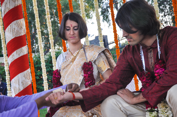 As the pandit rolls the sacred thread around Ashray's wrist