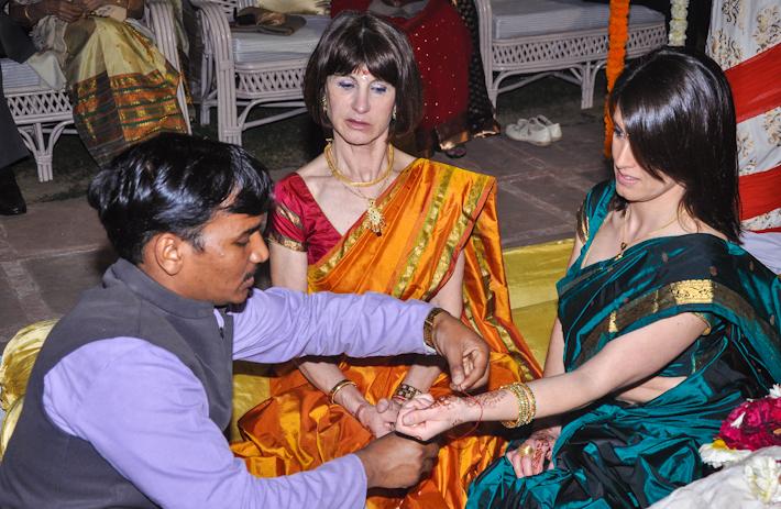 My Mom and Sis getting their sacred Hindu thread