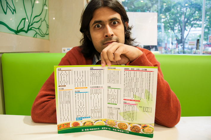 Ashray trying to choose lunch from a menu writen in Chinese