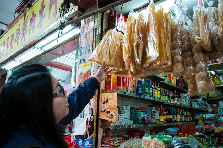 Joyce buying bean curd