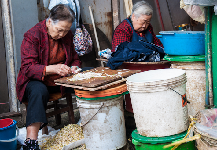 Old ladies separating bean sprouts - such a delicate job!