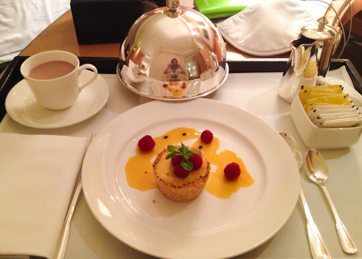 A little bit of room-service pampering: hot chocolate and passion fruit tart with raspberry coulis
