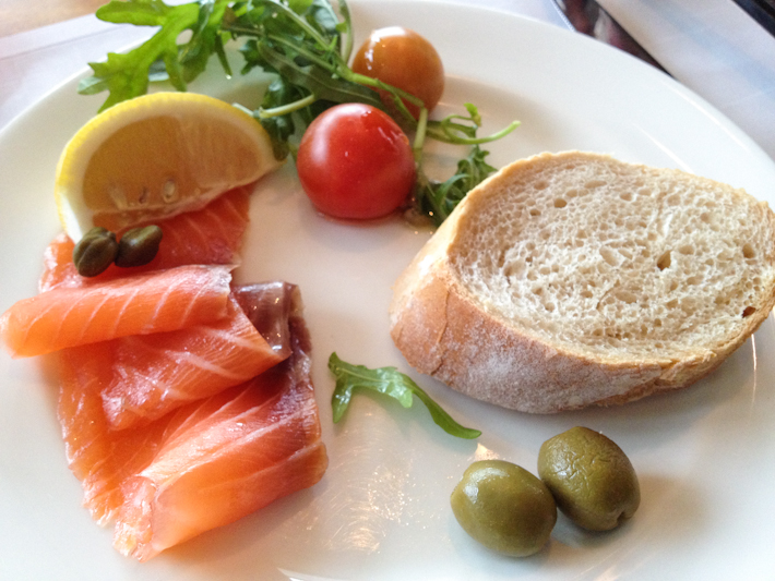 Fish course: smoked salmon with arugula and cherry tomatoes salad, olives and rustic bread