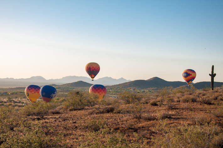 View of other balloons flying over the desert, as seen from our balloon!