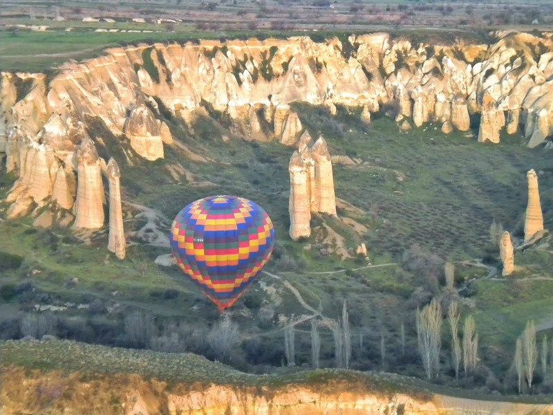 "Hot-air balloon over the ""Fairy Chimney"" rock formations in Cappadocia"