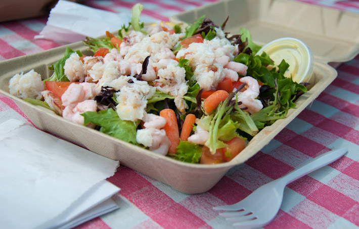 A $13 seafood salad in Oregon: in a paper box with plastic cutlery