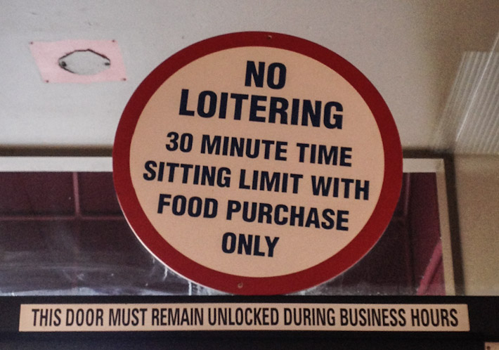 Certain diners and cafes do not allow you to sit inside for more than 30 minutes. This sign is fairly common.