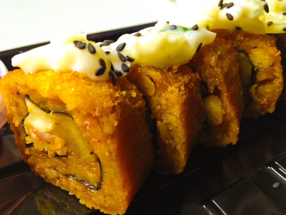 Example of Niqei cuisine: deep fried roll with Peruvian filling
