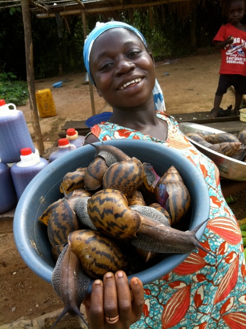 Lady with some MASSIVE snails in Ghana