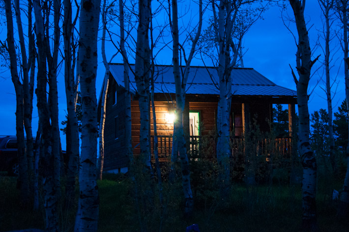 A Cabin In The Woods At Night